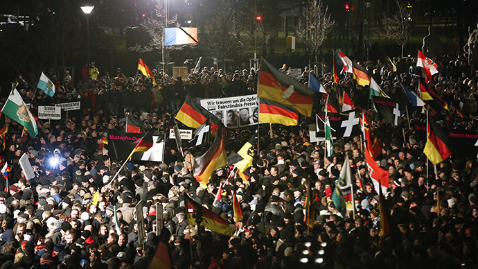 Supporters of anti-immigration movement Patriotic Europeans Against the Islamisation of the West (PEGIDA) hold flags during a demonstration in Dresden January 12, 2015. (Reuters / Fabrizio Bensch)