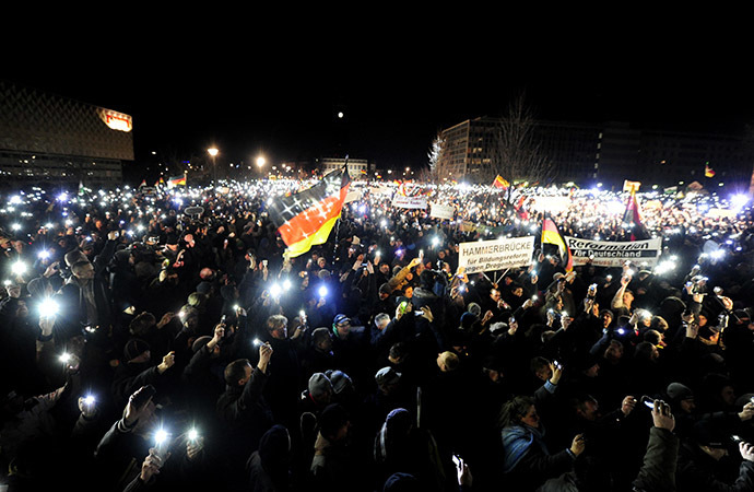 Sympathizers of German anti-immigration movement PEGIDA (Patriotic Europeans Against the Islamisation of the Occident) attend their twelfth march in Dresden, eastern Germany on January 12, 2015. (AFP Photo / Robert Michael)