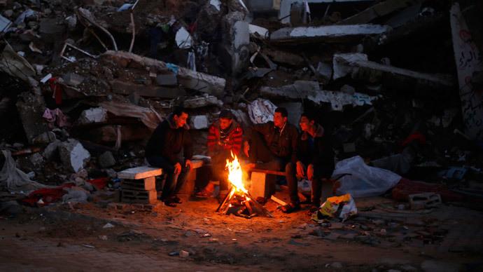 Gazans freeze amid rubble as post-war reconstruction stalls, int'l aid runs out