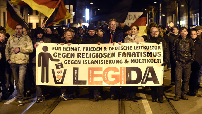 People with a poster reading 'For the fatherland, peace, German culture, against religious bigotry, against islamization and multi culture' attend a rally of LEGIDA, a local copycat of Dresden's right-wing populist movement PEGIDA (Patriotic Europeans Against the Islamisation of the Occident), in Leipzig, eastern Germany on January 12, 2015. (AFP Photo / Odd Anderen)