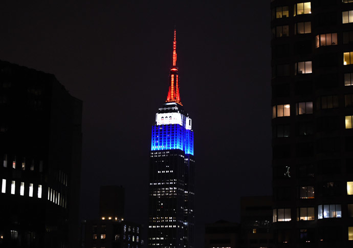 The Empire State building is lighted up in the colors of the French flag to pay tribute to those that lost their lives in the terrorist attacks at Charlie Hedbo on January 11, 2015 in New York. (AFP Photo / Timothy A. Clary)