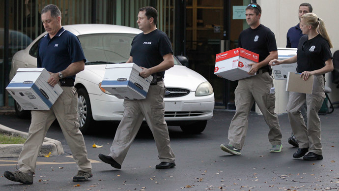 Law enforcement officials remove boxes of material from the office of Med-Care Diabetic & Medical Supplies Inc. in Boca Raton, Florida January 14, 2015.(Reuters / Andrew Innerarity)