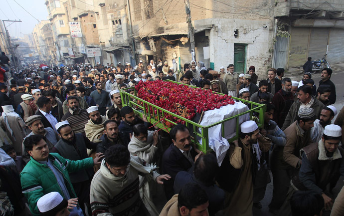 People carry the coffin of a male student who was killed in Tuesday's attack on the Army Public School, which was attacked by Taliban gunmen, during his funeral in Peshawar, December 17, 2014. (Reuters/Fayaz Aziz)