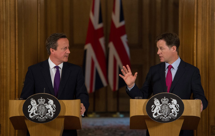 Britain's Prime Minister David Cameron (L) and Deputy Prime Minister Nick Clegg. (AFP Photo/Stefan Rousseau)