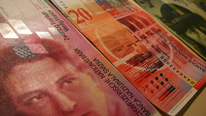 Swiss franc skyrockets to record level after central bank removes euro peg