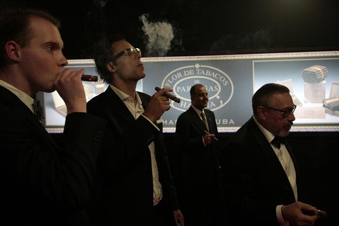 Cigar enthusiasts smoke smoke Cuban cigars (Reuters/Stringer)