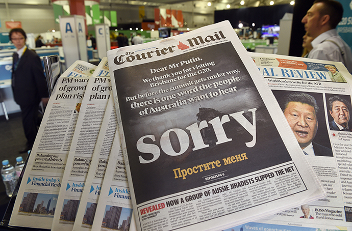 The front page of the local newspaper calls on Russia's President Vladimir Putin to apologize before the G20 Leader's Summit in Brisbane gets underway on November 14, 2014. (AFP Photo / William West)