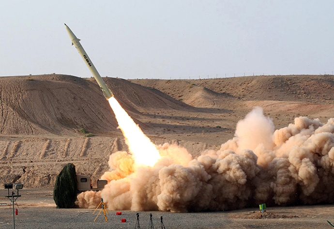 Test firing its home-built surface-to-surface Fateh 110 missile (AFP Photo / HO / Vahid Reza Alaei)