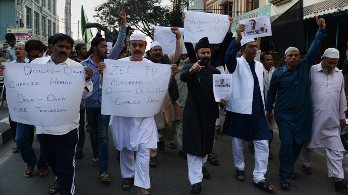 Indian Muslim activists from the Majlis Bachao Tahreek (MBT) shout slogans against the printing of satirical sketches of the Prophet Muhammad by French magazine Charlie Hebdo during a protest in Hyderabad on January 16, 2015.(AFP Photo / Noah Seelam)