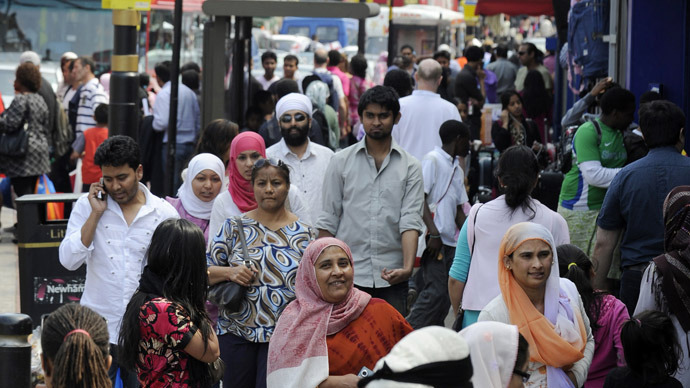 Shoppers walk in a market in the Upton Park neighborhood in east London (Reuters / Paul Hackett)