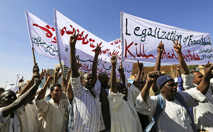 Muslims shout slogans against France and call for its apology while carrying banners during a demonstration against satirical French weekly Charlie Hebdo, which featured a cartoon of the Prophet Mohammad as the cover of its first edition since an attack by Islamist gunmen, after attending Jumma prayer in Khartoum January 16, 2015. (Reuters / Mohamed Nureldin Abdallah)