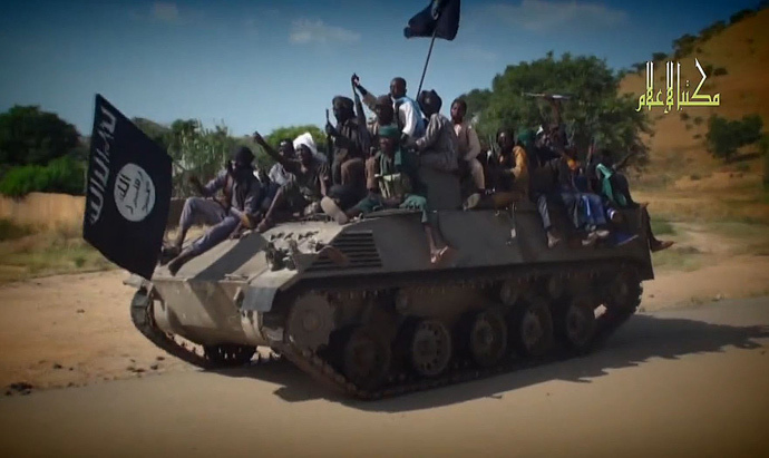 Boko Haram fighters parading on a tank in an unidentified town. (AFP Photo / HO / Boko Haram)