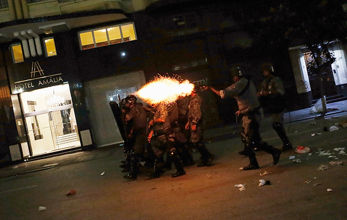 Riot police fire tear gas at demonstrators during a protest against fare hikes for city buses, subways and trains in Sao Paulo January 16, 2015 (Reuters / Nacho Doce)