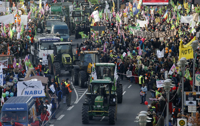 Tractors take part in protest of German farmers and consumer rights activists against the Transatlantic Trade and Investment Partnership (TTIP), mass husbandry and genetic engineering in Berlin, January 17, 2015. (Reuters/Fabrizio Bensch)