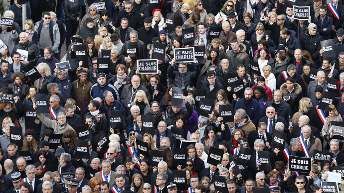 "Tens of thousands of people some holding up signs that read, ""Je suis Charlie"" march during a rally along the sea front in the Mediterranean city of Nice, on January 10, 2015 (AFP Photo / Valery Hache)"