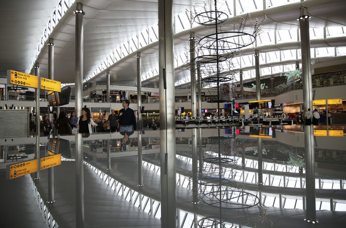 A view of the departure lounge is reflected in Terminal 2 at Heathrow Airport in London (Reuters/Neil Hall)