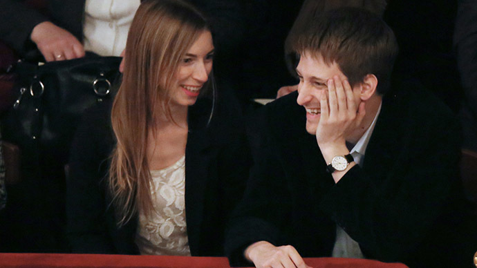 Former U.S. spy agency contractor Edward Snowden and his girlfriend Lindsay Mills in one of Moscow's theaters. (RIA Novosti/Anatoly Kucherena)