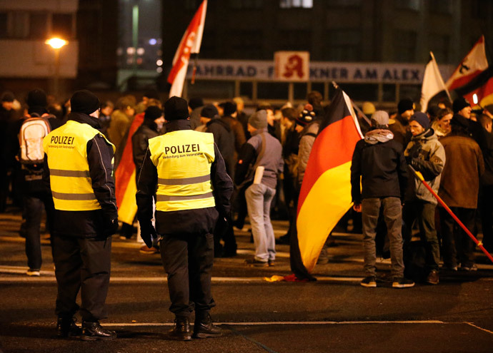 German police officers watch as members of BAERGIDA, Berlin's section of anti-immigration movement Patriotic Europeans Against the Islamisation of the West (PEGIDA) prepare to demonstrate in Berlin January 19, 2015. (Reuters / Fabrizio Bensch)