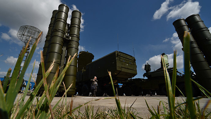 A visitor stands near an S-300 surface-to-air missile system as preparations are underway for the Engineering Technologies 2014 international forum in Zhukovsky near Moscow. (RIA Novosti/Ramil Sitdikov)
