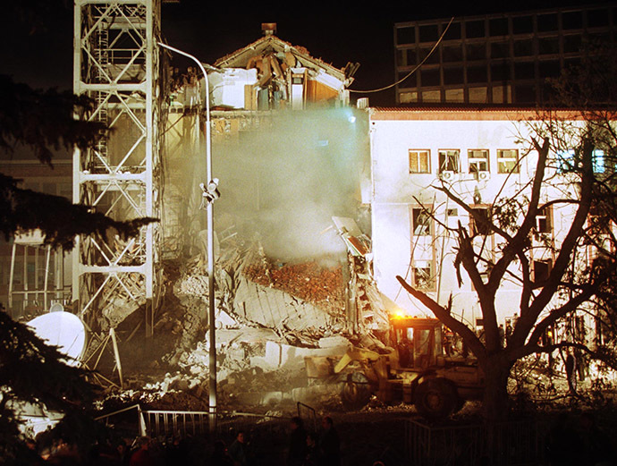 Work crews use a digger at the destroyed part of the Radio-Television Serbia building after a NATO air strike over Yugoslav capital early April 23, 1999. (Reuters)