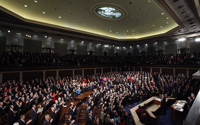 U.S. President Barack Obama receives a standing ovation as he begins to deliver his State of the Union address to a joint session of the U.S. Congress on Capitol Hill in Washington, January 20, 2015. (Reuters/Jonathan Ernst)