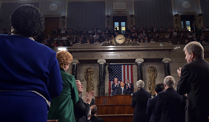 U.S. President Barack Obama (C) is applauded while delivering his State of the Union address to a joint session of Congress on Capitol Hill in Washington, January 20, 2015. (Reuters/Mandel Ngan)