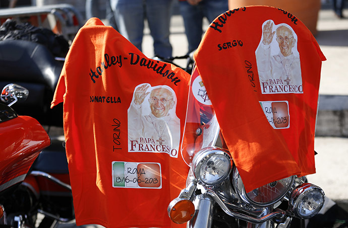 T-shirts with pictures of Pope Francis are hung over a Harley-Davidson bike before a mass led by Pope Francis in Rome June 16, 2013. (Reuters/Max Rossi)