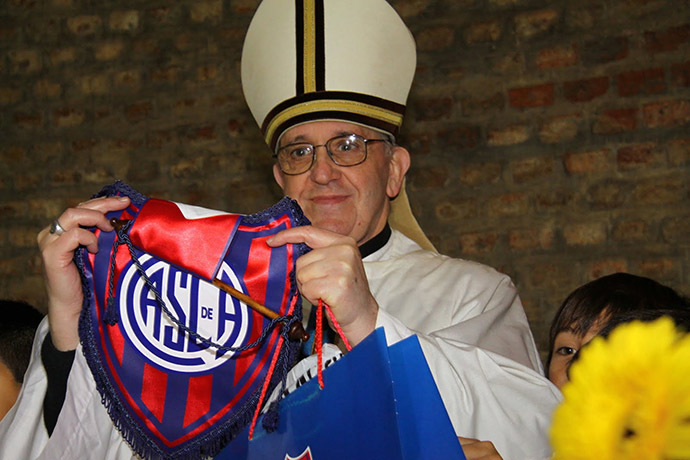 Argentine Cardinal Jorge Bergoglio poses with a jersey from the San Lorenzo soccer club, of which he is known to be a fan, in this undated handout photograph distributed by the club on March 13, 2013. (Reuters/San Lorenzo soccer club/Handout)