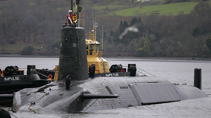Crew from HMS Vengeance, a British Royal Navy Vanguard class Trident Ballistic Missile Submarine, stand on their vessel as they return along the Clyde river to the Faslane naval base near Glasgow, Scotland. (Reuters/David Moir)