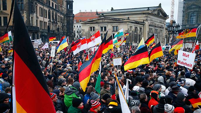 Members of the movement of Patriotic Europeans Against the Islamisation of the West (PEGIDA) hold flags and banners during a PEGIDA demonstration march in Dresden, January 25, 2015 (Reuters / Hannibal Hanschke)