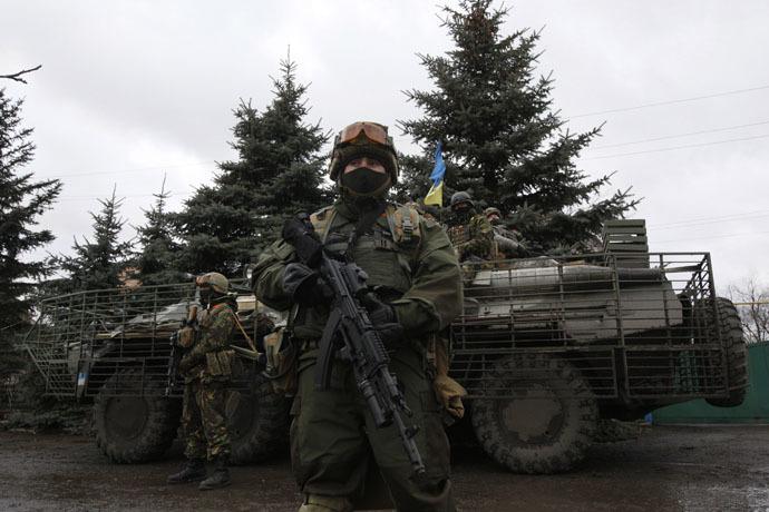 Ukrainian servicemen patrol an area near the eastern Ukrainian town of Debaltseve in Donetsk region (Reuters/Valentyn Ogirenko)