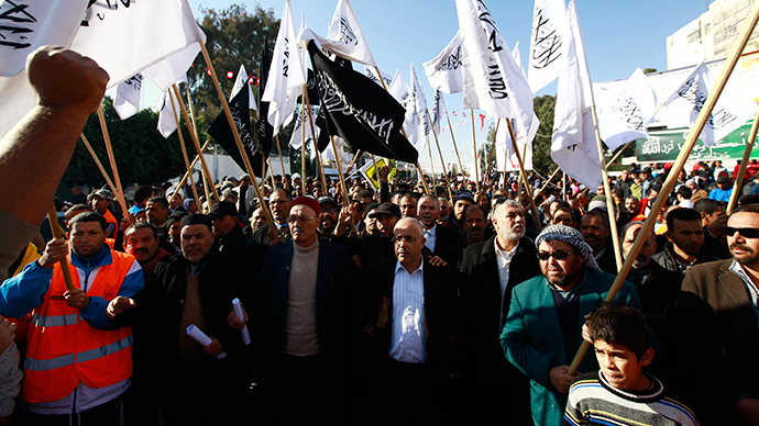 Supporters of Islamist party Hizb Ut-Tahrir wave flags during a rally in Sidi Bouzid December 17, 2013, to mark the third anniversary of the Tunisian revolution (Reuters / Anis Mili)
