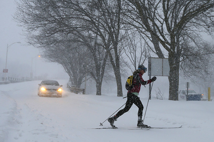 A woman cross country skis on snow covered roads during a blizzard in Boston, Massachusetts January 27, 2015. (Reuters/Brian Snyder)
