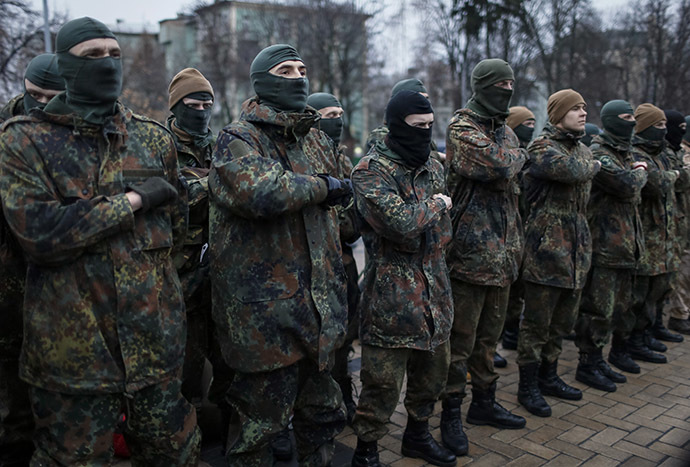 New volunteers for the Ukrainian Interior Ministry's Azov battalion line up before they depart to the frontlines in eastern Ukraine, in central Kiev January 17, 2015. (Reuters/Gleb Garanich)