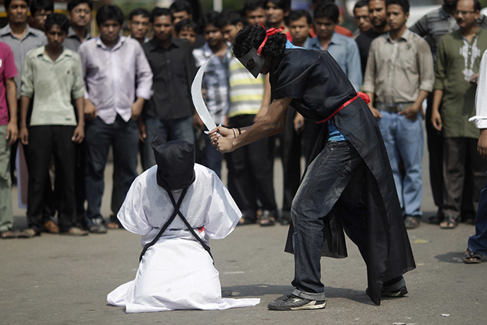FILE PHOTO: Members of Magic Movement stage a mock execution scene in protest of Saudi Arabia beheading of eight Bangladeshi workers in October 2011. (Reuters/Andrew Biraj)