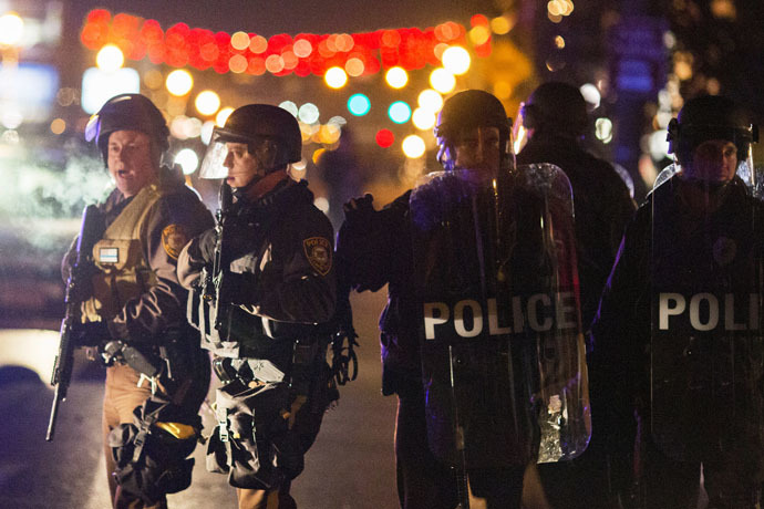 Police officers clear a street of protesters during a second night of unrest in Ferguson, Missouri, November 26, 2014. (Reuters/Lucas Jackson)