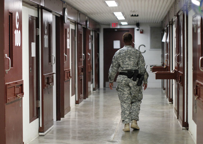 A guard walks through a cellblock inside Camp V, a prison used to house detainees at Guantanamo Bay U.S. Naval Base (Reuters/Bob Strong)
