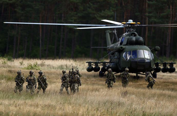 "Members of Poland's special commando unit Lubliniec disembark from a Mi-17 helicopter during the ""Noble Sword-14"" NATO international tactical exercise at the land forces training centre in Oleszno, near Drawsko Pomorskie, northwest Poland September 9, 2014. (Reuters/Kacper Pempel)"