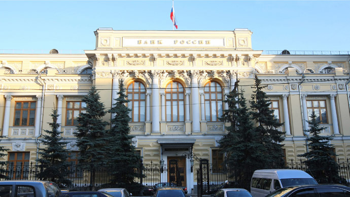 Russia's Central Bank unexpectedly slashes rate to 15%, ruble reels