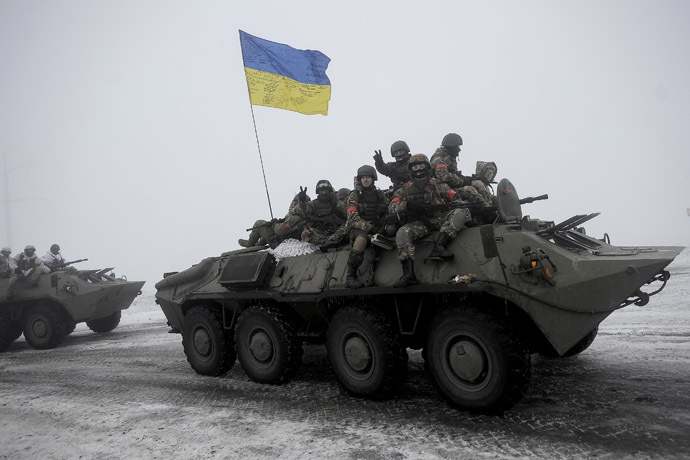 Ukrainian servicemen sit atop an armored personnel carrier (APC) as they patrol Orekhovo village in Lugansk region January 28, 2015.