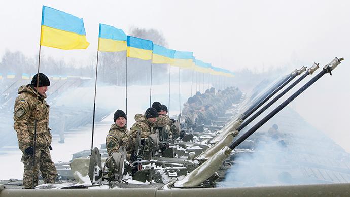 Ukrainian servicemen sit atop armoured personnel carriers (APC) (Reuters / Valentyn Ogirenko)