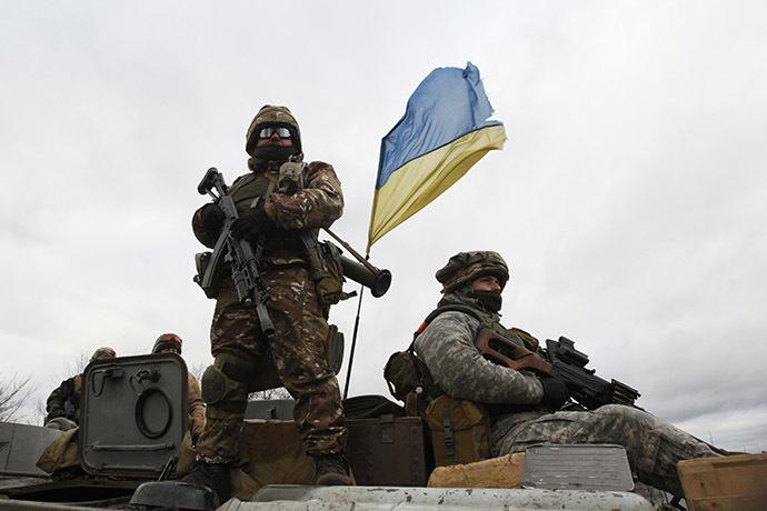 Ukrainian servicemen ride on an armored personnel carrier (APC) at a checkpoint near the eastern Ukrainian town of Debaltsevo in Donetsk region, December 24, 2014. (Reuters/Valentyn Ogirenko)