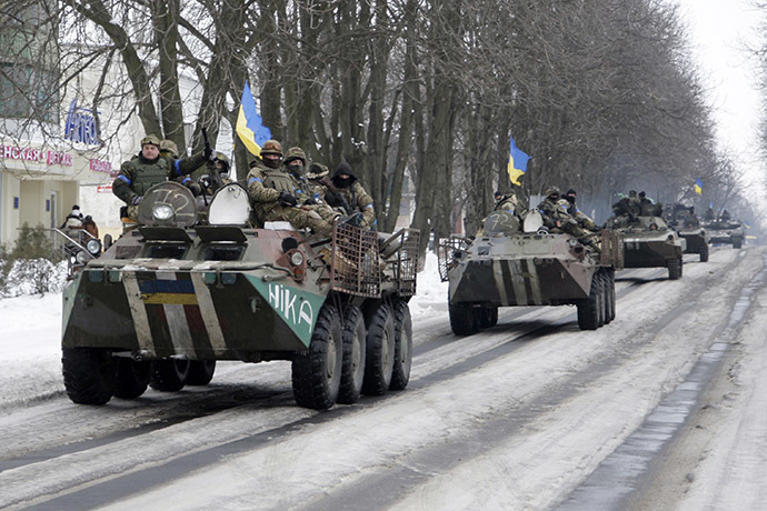 Members of the Ukrainian armed forces drive armored vehicles in the town of Volnovakha, eastern Ukraine, January 18, 2015. (Reuters/Alexander Ermochenko)