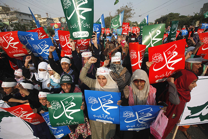 Supporters of Pakistan's political and religious party Jama'at e Islami chant slogans as they hold signs during a protest against satirical French weekly newspaper Charlie Hebdo, in Karachi January 25, 2015. (Reuters/Athar Hussain)