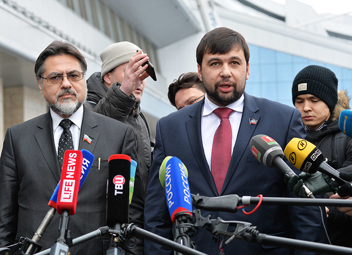 Representatives of the Donetsk and Lugansk People's Republics Denis Pushilin (R) and Vladislav Deinego answer journalists' questions at Minsk Airport, January 30, 2015. (RIA Novosti/Viktor Tolochko)
