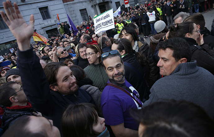 """Pablo Iglesias (L), leader of Spain's party """"Podemos"""" (We Can) waves as he attends a rally called by Podemos in Madrid January 31, 2015. (Reuters/Sergio Perez)"""