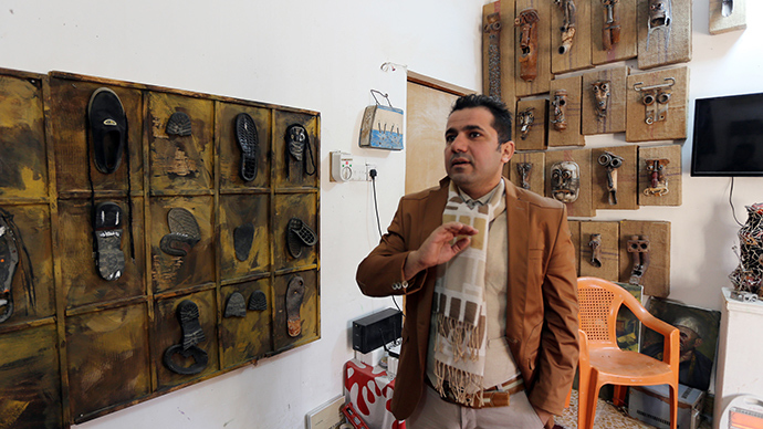 Iraqi artist fights 'ugly ISIS' with shoes & trash