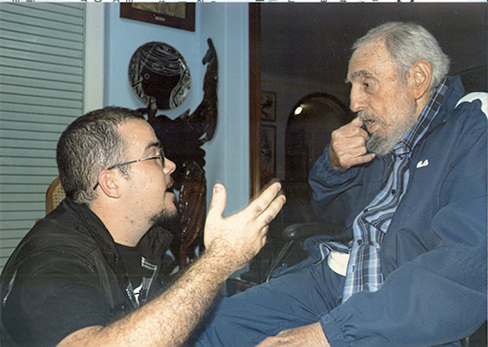 Former Cuban President Fidel Castro talks to President of Cuba's University Students Federation (FEU) Randy Perdomo during a meeting in Havana in this picture provided by Cubadebate. (Reuters/Cubadebate/Handout via Reuters)