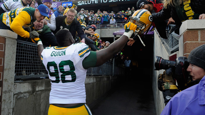 Packing a 'super bowl': Green Bay NFL player caught with 350 grams of pot, $190k, and a gun