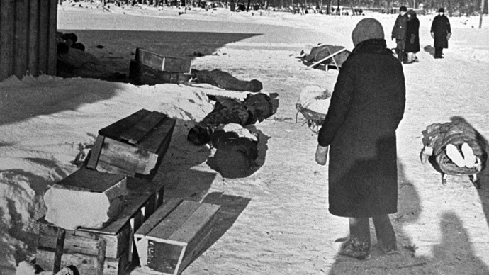 (ARCHIVE) A woman standing by corpses and coffins in besieged Leningrad. (RIA Novosti)